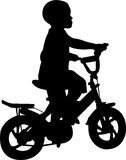 Boy riding bicycle. Silhouette of boy riding bicycle - vector royalty free illustration