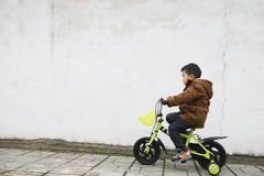 Boy riding bicycle Royalty Free Stock Photos