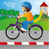 Boy riding a bicycle. With a helmet Royalty Free Stock Photos