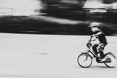 Boy riding a bicycle at high speed Stock Photo