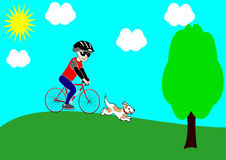 A boy riding a bicycle with his dog in a park Royalty Free Stock Photos