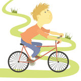 Boy riding bicycle Royalty Free Stock Photo