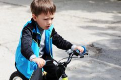 Boy riding bicycle Royalty Free Stock Image