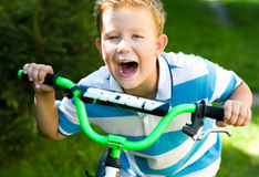 Boy riding a bicycle in the park Royalty Free Stock Photos