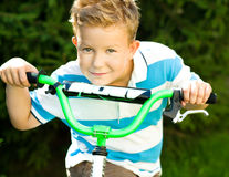 Boy riding a bicycle in the park Stock Image