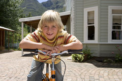 Boy riding bicycle in patio Royalty Free Stock Photos