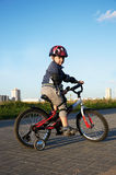 Boy riding bicycle Stock Photos