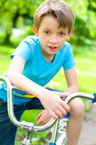 Boy riding bicycle. Young boy riding bicycle in the summer Stock Images