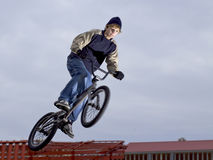 Boy riding bike Stock Images