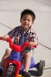 Boy riding a bike. Cute three years old little boy riding a 3-wheel bike Stock Images