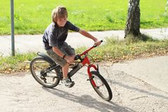 Boy riding a bike Stock Photos
