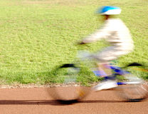 Boy riding a bike. Motion blur royalty free stock photos