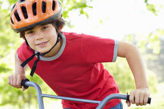 Boy riding bike. Smiling Royalty Free Stock Photos