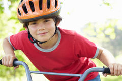 Boy riding bike Royalty Free Stock Image