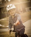 Boy riding bike. Happy boy riding bike on street Stock Image