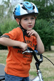 Boy riding bike Stock Photos