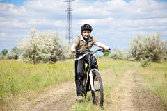 Boy riding bike in a helmet Royalty Free Stock Image