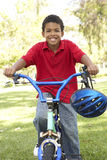 Boy Riding Bike In Park Stock Photos