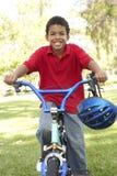 Boy Riding Bike In Park. African American Boy Riding Bike In Park Smiling stock photos