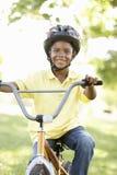 Boy Riding Bike In Park Royalty Free Stock Image
