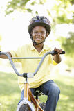Boy Riding Bike In Park Stock Images