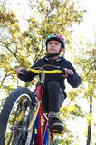 Boy riding a bike in the park Royalty Free Stock Photos