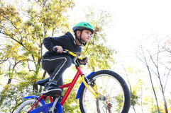 Boy riding a bike in the park Royalty Free Stock Photo