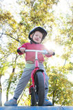 Boy riding a bike in the park Stock Image