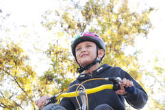 Boy riding a bike in the park Royalty Free Stock Image