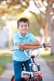 Boy Riding Bike On Path. Smiling Royalty Free Stock Photography