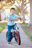 Boy Riding Bike On Path Royalty Free Stock Photos