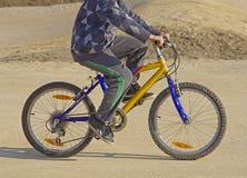 Boy riding a bike. Side view of boy on bike Stock Photos