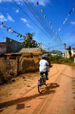 Boy riding bike at Vietnam countryside Stock Photo