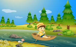 A boy riding a boat Stock Photo