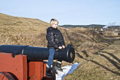 Boy riding a cannon. Stock Photo