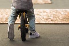 Boy riding. Close up boy riding a bicycle Stock Photos