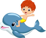 Boy riding dolphin Stock Images
