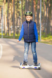 Boy riding electrical scooter Stock Photo