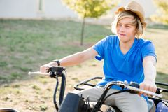 Boy riding farm truck in vineyard royalty free stock photo
