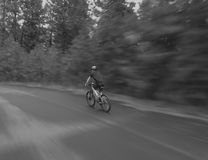 Boy riding fast on bike Stock Images