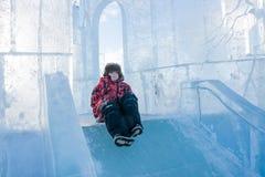 Boy riding a frozen hill Stock Photos
