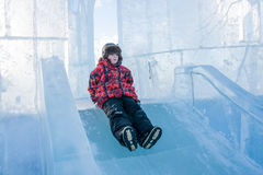 Boy riding a frozen hill Royalty Free Stock Photo
