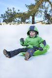 Boy riding the hills on sleds Royalty Free Stock Photo