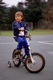 Boy riding his bicycle Royalty Free Stock Photography