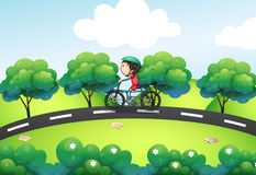 A boy riding in his bike at the street. Illustration of a boy riding in his bike at the street stock illustration