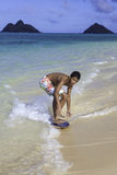 Boy riding his skimboard Royalty Free Stock Photos