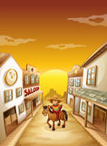 A boy riding in a horse outside the saloon Royalty Free Stock Photography