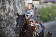 Boy riding horse Stock Photo