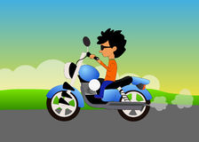 Boy riding motorcycle Stock Photos
