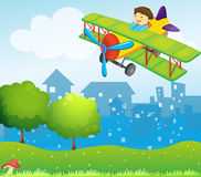 A boy riding in a plane above the hill Royalty Free Stock Photos
